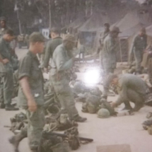 Vietnam, 1966. Tom is the one looking down at his gear.